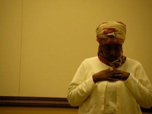 Woman praying at Muslim Center of Detroit
