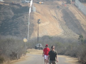 Frankie and Craig walking along the border wall